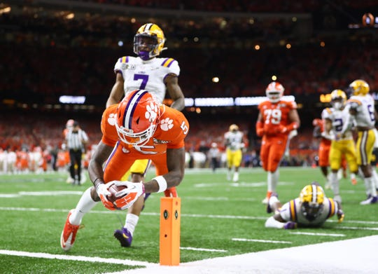Clemson Tigers wide receiver Tee Higgins scores a touchdown against the LSU Tigers in the College Football Playoff national championship game.