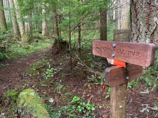 Signs point up the North Ridge Trail at Marys Peak west of Corvallis.