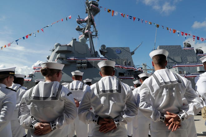 In this Saturday, July 27, 2019, file photo, sailors stand during a commissioning ceremony for the U.S. Navy guided missile destroyer USS Paul Ignatius, at Port Everglades in Fort Lauderdale, Fla.