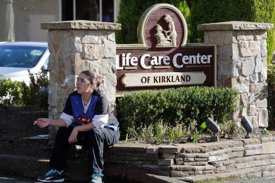 Antonia Lopez, a contract phlebotomist, takes a break from her work at Life Care Center of Kirkland, a nursing facility where more than 50 people are sick and being tested for the COVID-19 virus Feb. 29, 2020, in Kirkland, Wash.