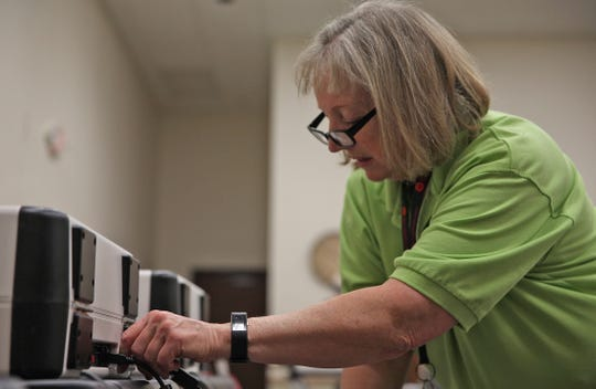 Tom Green County elections administrator Vona Hudson sets up voting equipment at MHMR Services in San Angelo on Monday, March 2, 2020 before the election. The primary runoffs are July 14 in Texas.