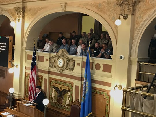 Two dozen first responders watch the House debate on a proposal to study first responders' mental health in South Dakota on Monday afternoon.