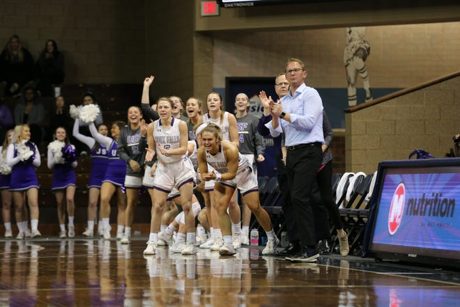 USF players and coach Travis Traphagen cheer on their team Sunday at the Pentagon.