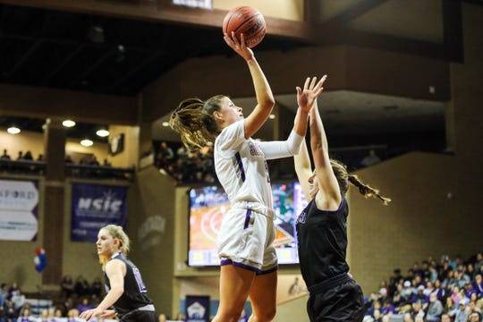 Anna Goodhope goes up for two of her 23 points in USF's win over Winona State