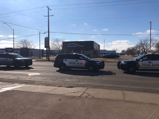 Police block a lane of traffic on W. 41st Street near West Avenue after a man caused a crash while suffering a medical emergency on Monday in Sioux Falls.