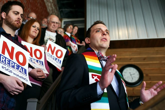 The Rev. Caleb Lines of South Street Christian Church speaks at One Springfield's event opposing the effort to repeal language including sexual orientation and gender identity in Springfield?s nondiscrimination ordinance during an event organized by One Springfield at The Old Glass Place in downtown Springfield on Thursday, Feb. 26, 2015.