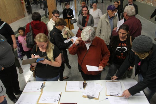 People sign up for committees at the first meeting of One Springfield, a new group formed to campaign to keep the recently-passed SOGI bill, on Monday, November 10, 2014.