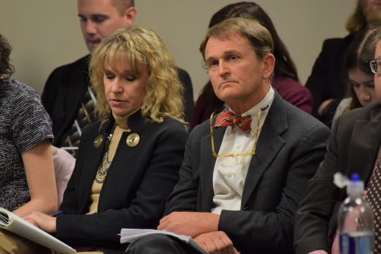 Department of Health and Senior Services Director Randall Williams, right, with bowtie, listens to testimony during a meeting on the state's preparations for the coronavirus on Monday, March 2, 2020.