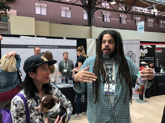 Colorado cannabis entrepreneur Farrah Vorhauer (with dog Nugget) and Philadelphia-area Souful Cannabis activist Jason Mitchell attended MoCannBizCon+Expo in downtown St. Louis on Monday, March 2, 2020.