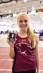 Leah Wood, a Stuarts Draft sophomore, shows her medal for winning the pole vault competition at the Class 1A/2A indoor state track meet Friday at Roanoke College.