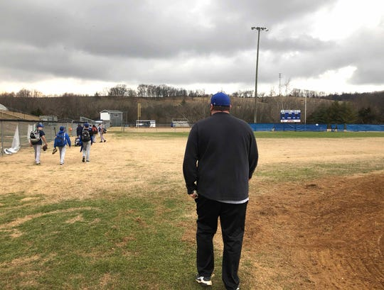 Fort Defiance head baseball coach Damian Fink walks off the field and toward the locker room Wednesday, February 26, to let players know if they made the team or not.