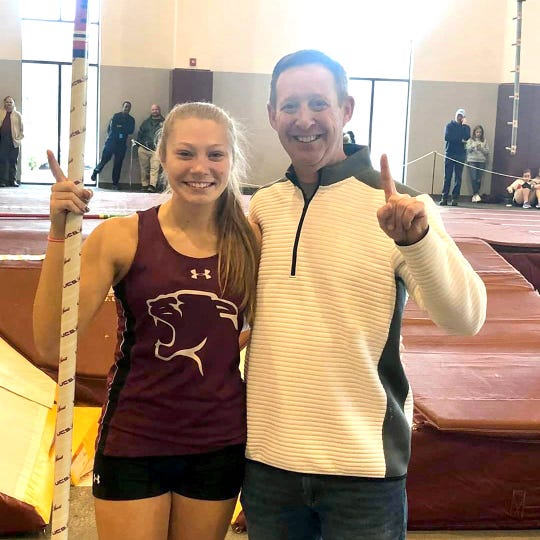 Stuarts Draft's Leah Wood with her pole vaulting coach, Amherst's Lance Carter.