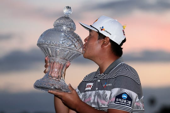 Sungjae Im of South Korea kisses the trophy after winning the Honda Classic golf tournament, Sunday, March 1, 2020, in Palm Beach Gardens, Fla.