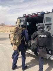 An El Paso police SWAT team is shown Monday, March 2, 2020, at an Upper Valley home in the 900 block of White River Place near Artcraft Road and Westside Drive after a man locked himself inside a home.