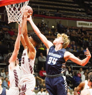 Redwood's Joey Volchko plays against Independence during the Central Section Division II championship boys basketball game in March 2020.