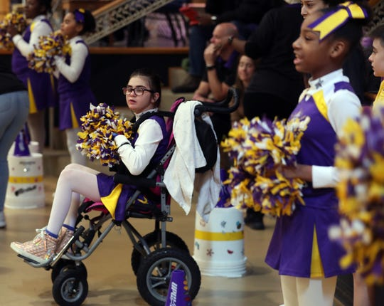 Keira (Kiki) Cunningham, 10, cheers with the Upward squad at Gracepoint Gospel Fellowship in New City Feb. 29, 2020. Kiki suffered a brain hemorrhage and stroke at age 8, and is now recovering at home.
