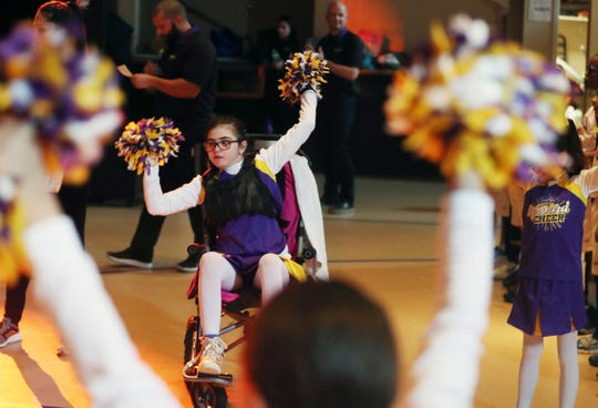 Keira (Kiki) Cunningham, 10, cheers with her Upward squad at Gracepoint Gospel Fellowship in New City Feb. 29, 2020. Kiki suffered a brain hemorrhage and stroke at age 8, and is now recovering at home.