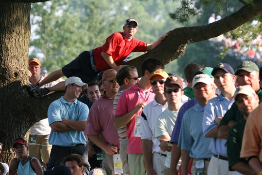 Fans watch the action on the 14th hole during the final round of the U.S. Open Championship at Winged Foot in Mamaroneck June 18, 2006.