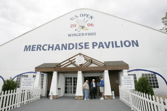 Customers chat with a greeter at the entrance of the U.S. Open Championship Merchandise Pavilion at Winged Foot Golf Club in Mamaroneck June 9, 2006. The pavilion is open to the public from 10 a.m. to 6 p.m. through the weekend.