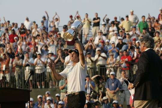 Geoff Ogilvy holds up his trophy after winning with a score of +5 during the final round of the U.S. Open Championship at Winged Foot Golf Club in Mamaroneck, New York, Sunday, June 18, 2006.