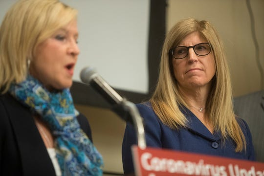 Director of the Division of Public Health Dr. Karyl Rattay, right, watches on as Lieutenant Governor Bethany Hall-Long speaks during a press conference on the state's response to coronavirus Monday at Christiana Care.
