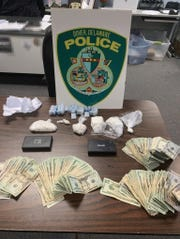 Dover Police arrested two men Friday afternoon after a search of their hotel room yielded nearly a pound of cocaine, other drugs and more than $4,500 in cash.