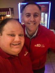 Jason Berger with NBC 10's Tim Furlong at Grotto Pizza in Wilmington after filming a news segment on the opera singer last week.