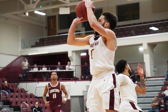 Drew Rackley fires a shot while playing for the University of Charleston. After graduating from John Glenn High School, Rackley started his career at UNC-Asheville before transferring to Charleston for his final two seasons.