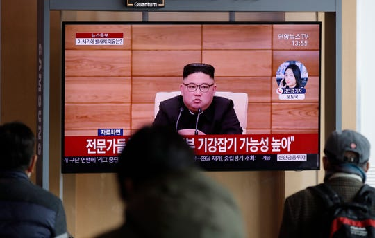 People watch a TV screen showing a news program reporting about North Korea's firing projectiles with a file footage of North Korean leader Kim Jong Un at the Seoul Railway Station in Seoul, South Korea, Monday, March 2, 2020. North Korea fired two unidentified projectiles into its eastern sea on Monday as it begins to resume weapons demonstrations after a months-long hiatus that could have been forced by the coronavirus crisis in Asia.