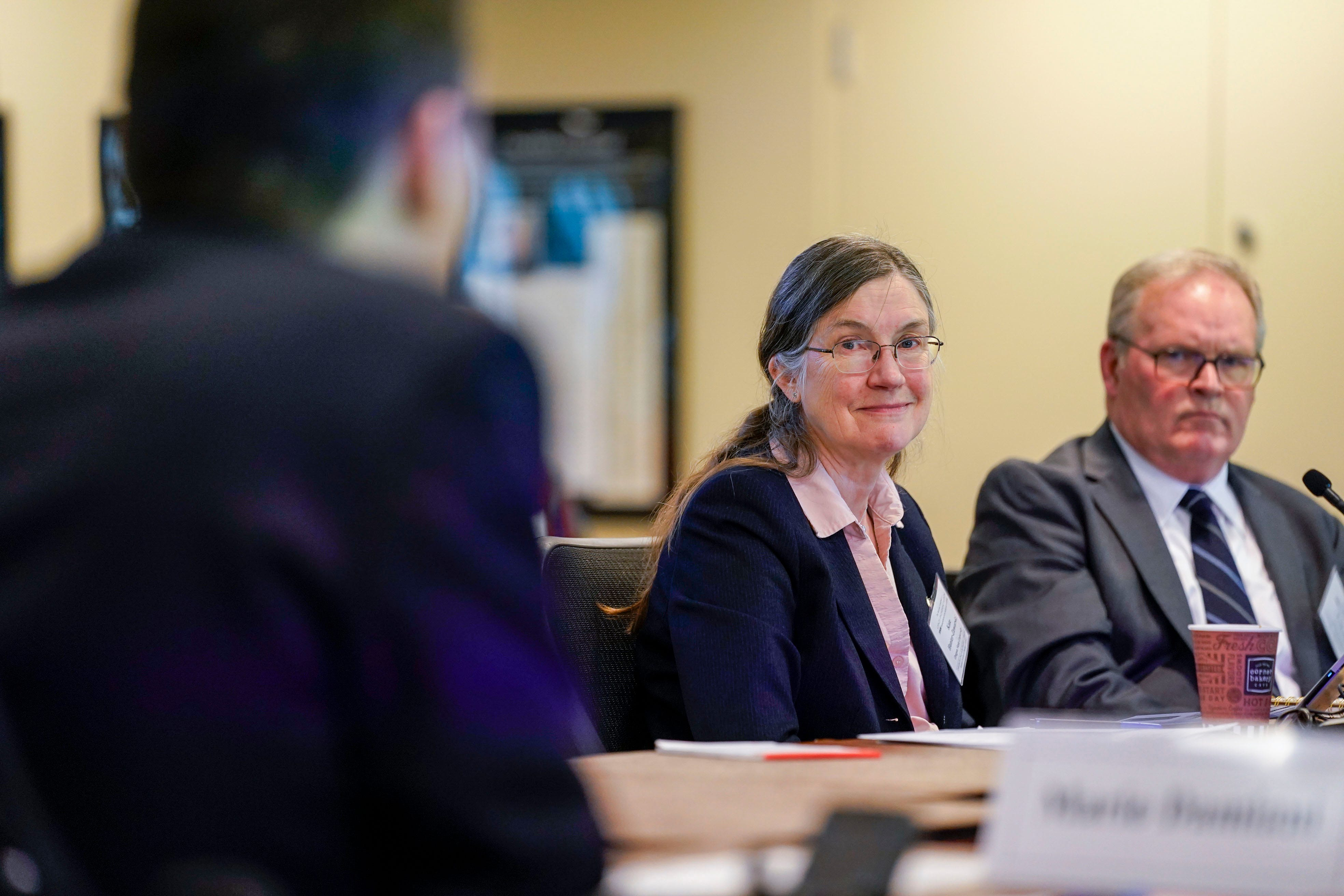 Board member Katharine M. Hunter-Zaworski listens in during the National Transportation Research Board meeting on the possibility of including wheelchairs on commercial flights in Washington, D.C.