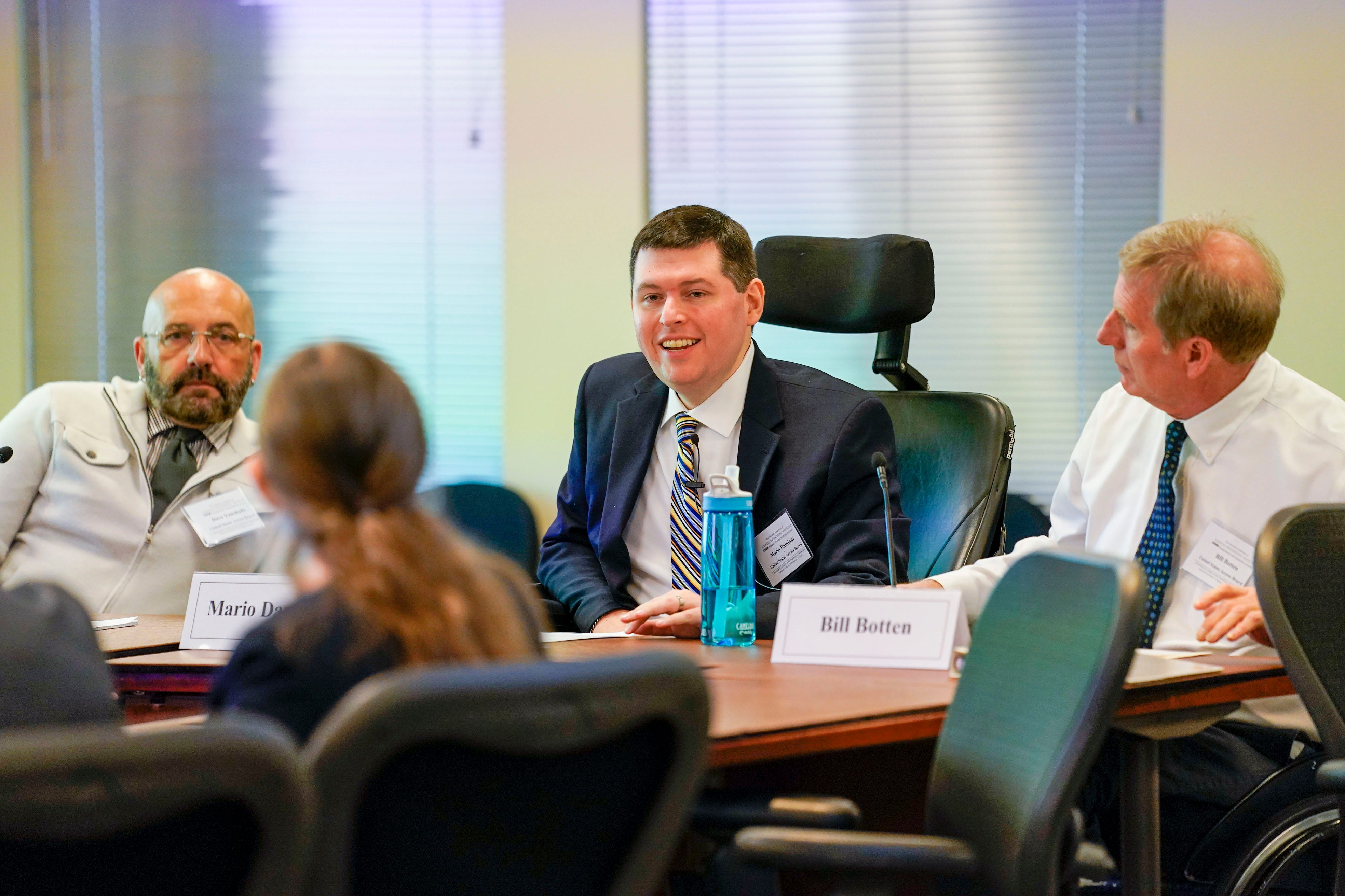 Access Board member Mario Damiani, center, fields questions during the National Transportation Research Board meeting.