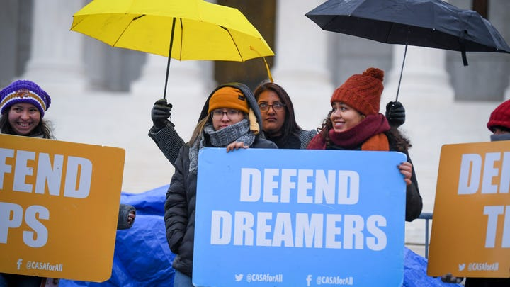 Demonstrators stood in the cold and rain outside the Supreme Court in November as the justices heard arguments on whether the Trump administration's decision to end the Deferred Action for Childhood Arrivals program (DACA) was lawful.