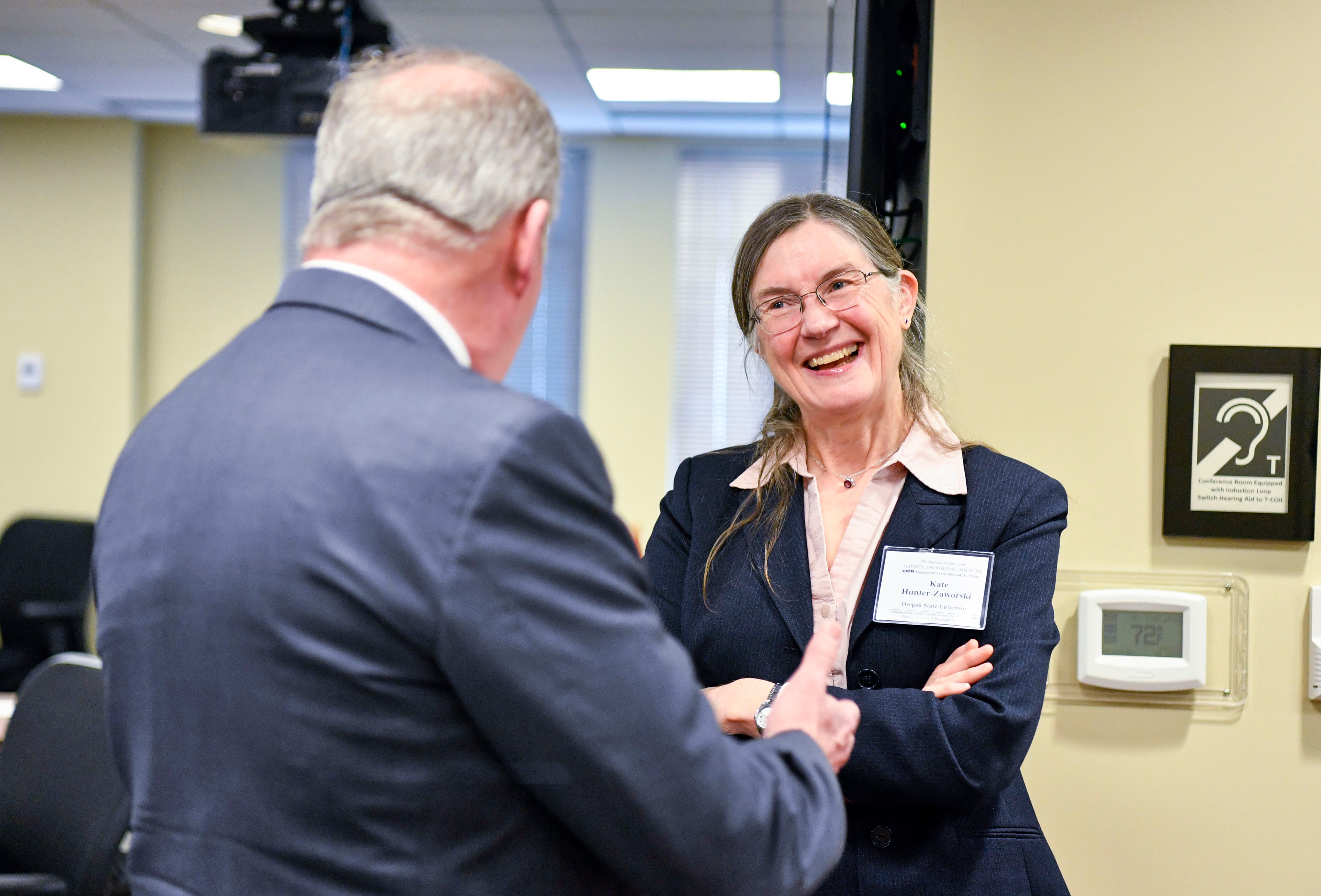 Board member Katharine M. Hunter-Zaworski talks to another member during the National Transportation Research Board meeting on the possibility of including wheelchairs on commercial flights in Washington, D.C. on Wednesday, Feb. 5, 2020.
