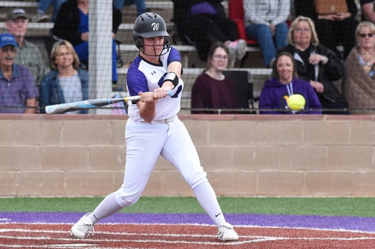 Wylie's Bailey Buck (4) swings at a pitch against Odessa High at Lady Bulldog Field on Monday, March 2, 2020. The Lady Bulldogs fell 5-3.