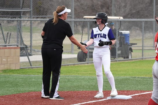 Wylie coach Heather Collier gives Rylee Moore (1) a high-five after a triple against Odessa High at Lady Bulldog Field on Monday. Moore had two hits, an RBI and scored a run along with pitching two scoreless innings of relief in the 5-3 loss.
