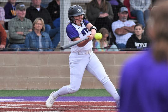 Wylie's Molly Mason (15) delivers a base hit after an 11-pitch at bat against Odessa High at Lady Bulldog Field on March 2. Mason is going to Cisco for basics to purse a career in development psychology.