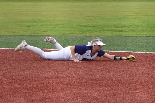 Wylie second baseman Kylie Barnes (13) lays out to catch a line drive against Odessa High at Lady Bulldog Field on Monday. Barnes had two hits, including a double, scored a run and drove in a run as the Lady Bulldogs fell 5-3.