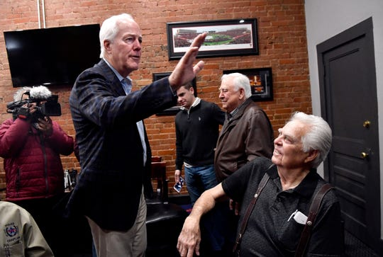 U.S. Sen. John Cornyn waves to a supporter before speaking to Abilenians, Republican supporters and media during a Super Tuesday campaign stop at Cypress Street Station.