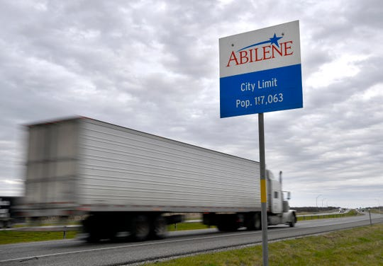 An 18-wheeler passes the city limits sign for Abilene on the eastbound side of Interstate 20 near Tye on Tuesday.