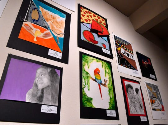A selection of work from students at Mann Middle School on display at The Grace Museum.