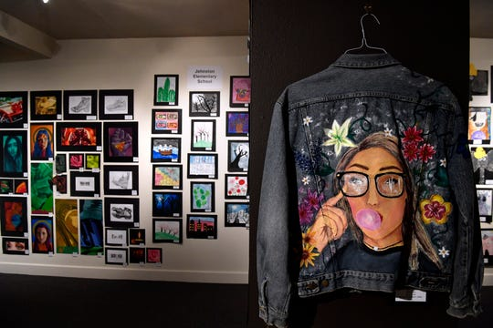 "Lexi Smith of Hawley High School created ""Second Skin"" on a denim jacket which hangs in the Grace Museum Feb. 28, 2020. Youth Art Month features hundreds of original art pieces by Big Country students."