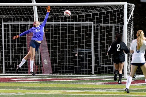 Roberson's Hannah Weas leaps as an Asheville shot goes into the net during their game at Asheville High School on March 2, 2020.