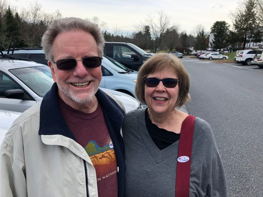 """Bob Debrecht, a Republican, and Mary Daughtridge, a self-described """"bleeding heart liberal,"""" have been happily married for 11 years, despite their political differences. They voted at Roberson High School in the March 3, 2020 primary."""