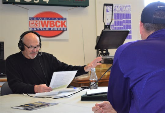 At his usual spot at Jack Pearl's Team Sports in downtown Battle Creek, Terry Newton serves as the host of Coaches Corner. He will broadcast his final show later this month after 32  years.