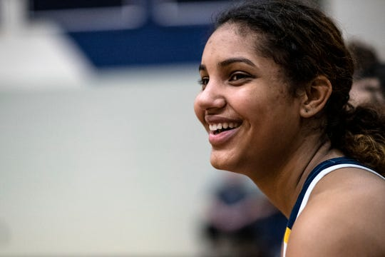 Battle Creek Central junior Arieonna Ware (15) cheers on her team during the first round of the Division 1 Girls Basketball District on Monday, March 2, 2020 at Gull Lake High School in Richland, Mich. This week, Ware signed with the University of Toldeo.