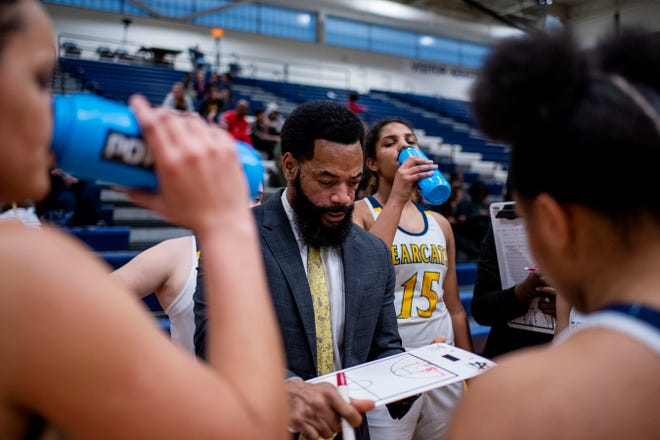 Battle Creek Central varsity girls basketball head coach Tony Warren goes over a play during the first round of the Division 1 Girls Basketball District on Monday, March 2, 2020 at Gull Lake High School in Richland, Mich.