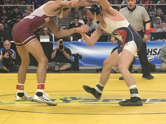 Chenango Forks' Tyler Ferrara, right, and Bay Shore's Elijah Rivera clinch during the first period of their 106-pound Division I title match Saturday at Albany's Times Union Center. Rivera won a controversial 6-4 overtime decision.