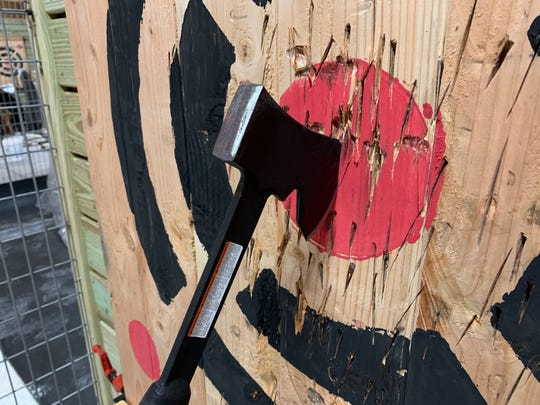 A hatchet finds its mark in the bullseye at Stumpy's Hatchet House in Cocoa Village.