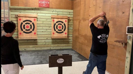 Mike Ewals takes a shot at the target at Stumpy's Hatchet House in Cocoa Village.
