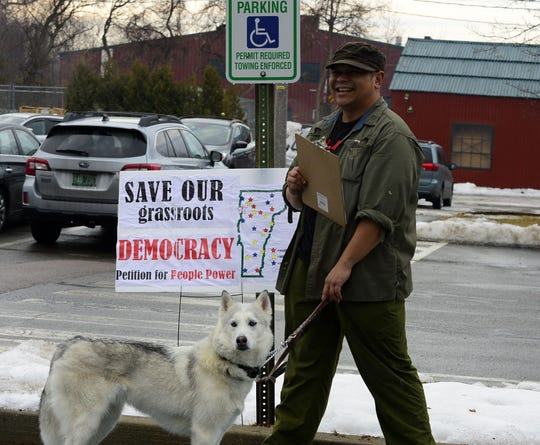 """Faried Munarsyah with his dog was collecting petitions for the city to have binding referendums outside the Burlington Ward 5 polling station at the Burlington Electric department on Tuesday morning, March 3, 2020. """"If you make people matter in elections, elections will matter,"""" he said. """"If people feel they have something at stake, they would turn out."""""""